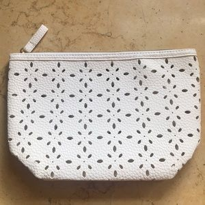 NWOT small white perforated clutch w/mirror inside
